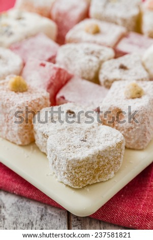 Assortment of Turkish Delight in a square plate on wooden white background