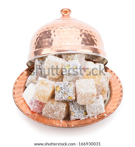 Assortment of Turkish delight in traditional copper bowl isolated on white background - stock photo