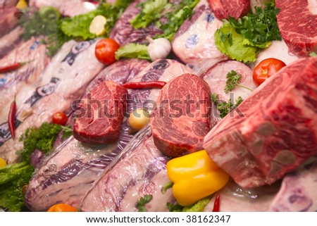 Assortment of U.S. export meat. Some veterinary service stamps are visible, trademarks blurred/deleted - stock photo