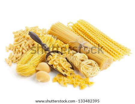 assortment of uncooked pasta isolated on white background - stock photo