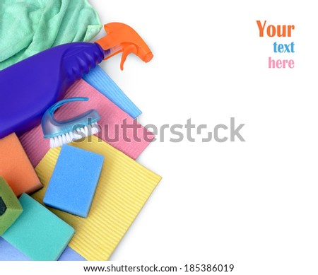 Assortment of various bright means for cleaning isolated on white background with space for text labels. Container with liquid for glass, wipes, colorful sponges for washing, blue cleaning brush - stock photo