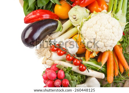 Assortment of various fresh organic vegetables from the garden isolated on white - stock photo