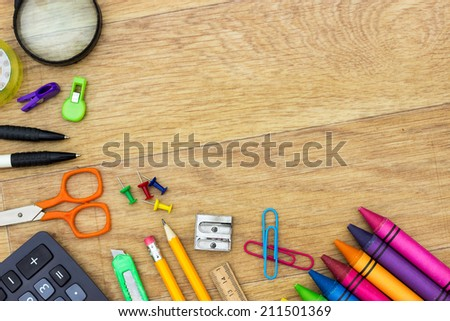 Assortment of various school items on wooden background  - stock photo