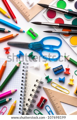 Assortment of various school items, white background - stock photo