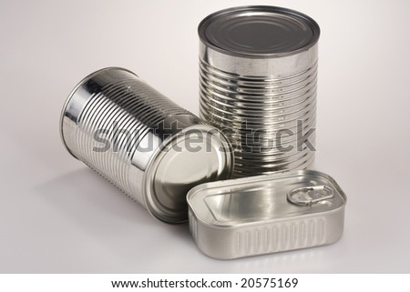 Assortment of various silver tin can, without labels - stock photo