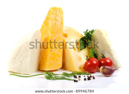 Assortment of various types of cheese  on a white background - stock photo