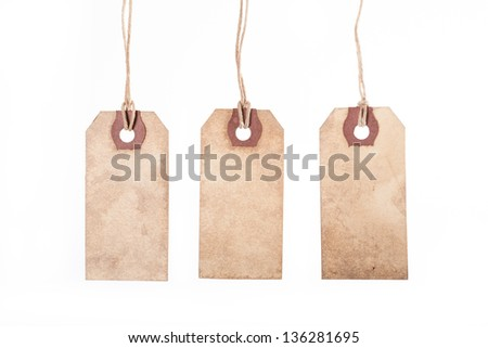 Assortment of vintage tags and labels with texture and stain details. White background - stock photo