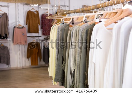 Assortment of warm clothing in modern garment store interior