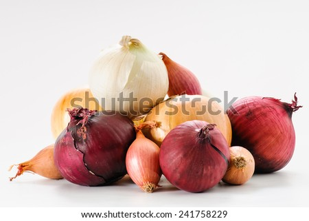 Assortment of White, Purple, Yellow Onions and Shallots - stock photo
