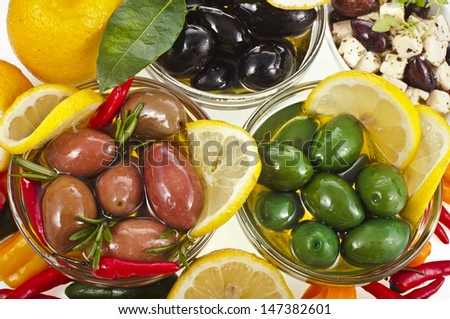 assortment olives dish with variety vegetables, herbs, spices on a white background  - stock photo