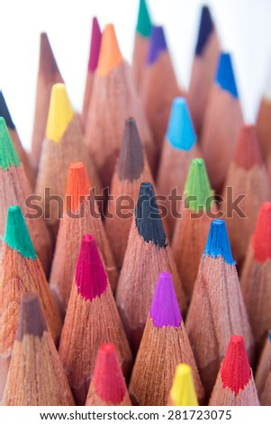 Assortment stack of colored wood drawing pencils - stock photo