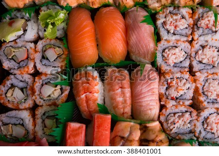 Assortments of sushi on black rectangle plate
