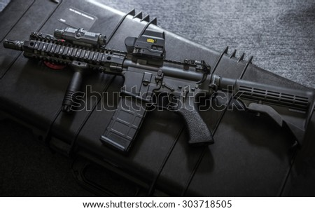 assult rifle on the rlfle case - stock photo