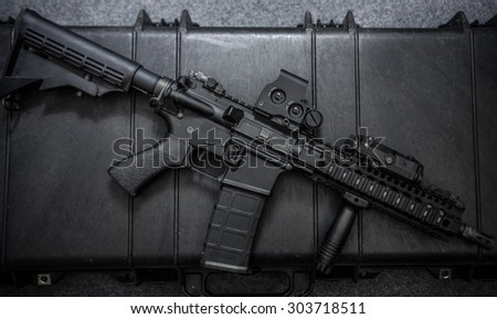 assult rifle right side ,focus red dot sight on picatiny rail  - stock photo