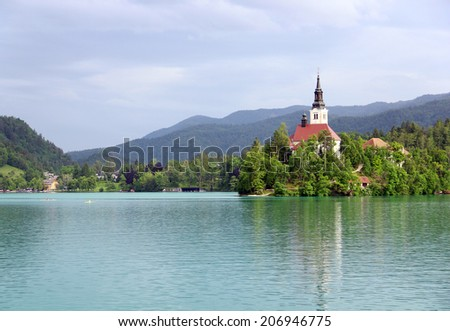 Assumption of Mary Pilgrimage Church on the island at Bled lake, Slovenia - stock photo