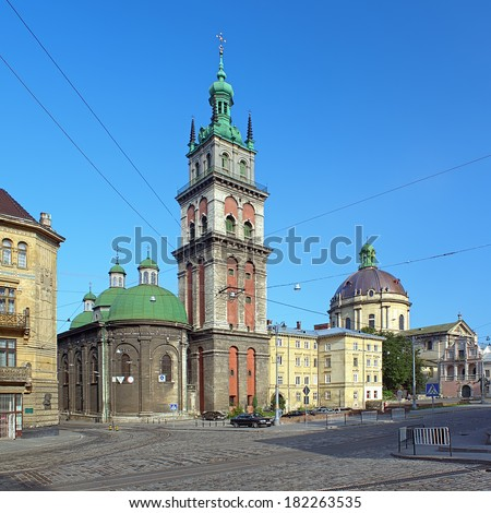 Assumption Orthodox Church with Korniakt Tower and Dominican Catholic Church in Lviv, Ukraine