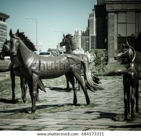 ASTANA, KAZAKHSTAN - MAY 10, 2011:Monument to horses on the streets of modern Astana