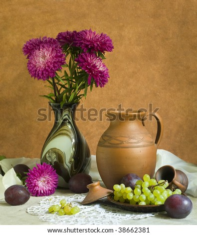 asters with grapes and plums - stock photo