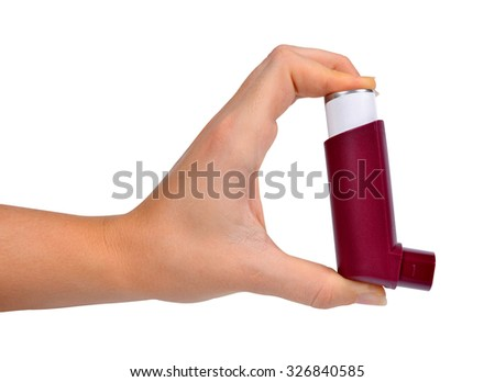 Asthma inhaler in hand isolated on white background