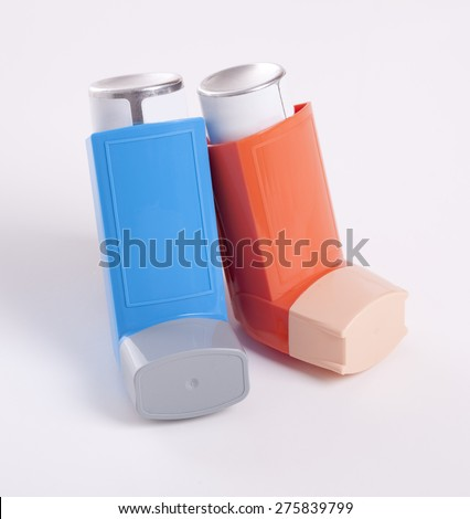 Asthma inhalers isolated on a white background - stock photo