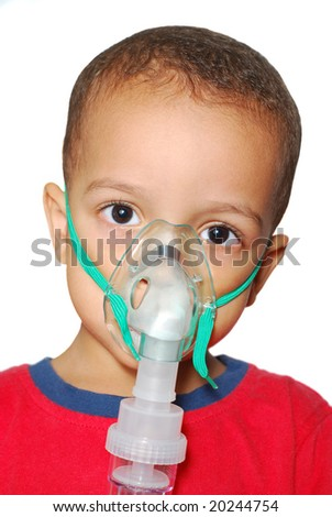 Asthmatic Child on a nebulizer - stock photo