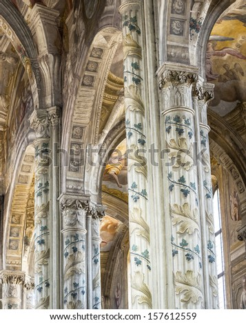ASTI, ITALY - JUNE 25, 2013: Interior of the Cathedral of Asti (Piedmont), on June 25, 2013. This catholic place of worship,, in baroque style, has plenty of fresco paintings and is open to visits.