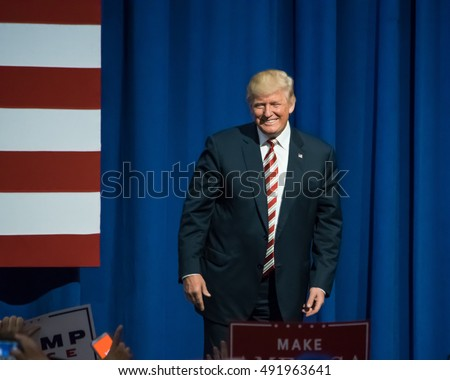 ASTON, PA - SEPTEMBER 22, 2016: Donald Trump on stage as he smiles at the cheering crowd. Trump held a rally at Sun Center Studios as the republican nominee for US President.