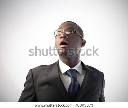 Astonished african businessman - stock photo