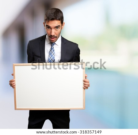 Astonished businessman with a name card