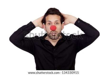 Astonished businessman with clown nose isolated on white background - stock photo