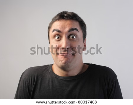 Astonished man - stock photo