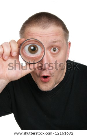 Astonished man see through magnifying glass isolated over white background - stock photo