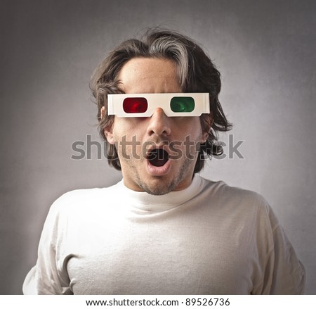 Astonished man wearing 3d glasses - stock photo