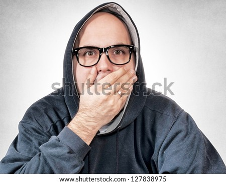 Astonished man with hood on his head - stock photo