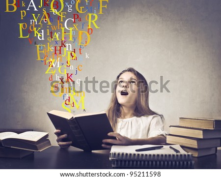 Astonished teenage girl reading a book with alphabet letters flying from it - stock photo