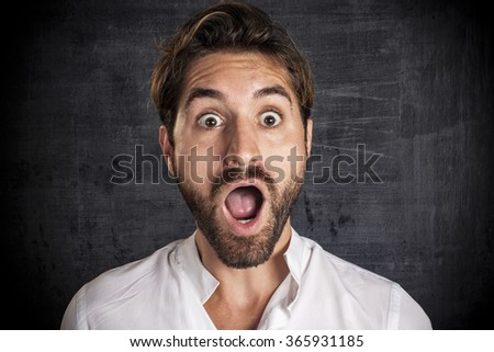 Astonished young businessman - stock photo