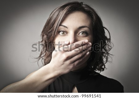 Astonished young woman - stock photo