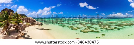 Astonishing panoramic view of the paradise coastline around the island with other islands on the horizon on Seychelles, La Digue. - stock photo