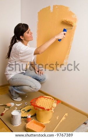 Astrid (23 years) colours her first flat - stock photo