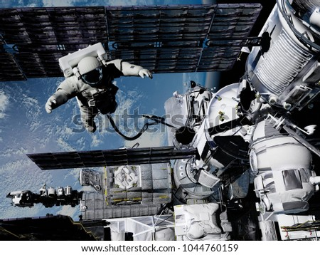 Astronaut and space station in Earth lanshafty background. ,3d render