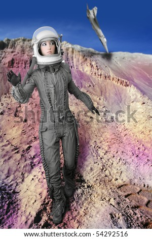 astronaut fashion woman aircraft crash space suit helmet moon landscape - stock photo