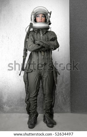 astronaut fashion woman full length space suit helmet silver studio background - stock photo