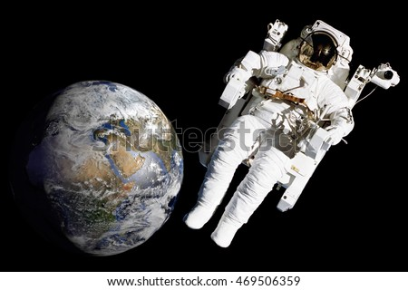 Astronaut floating in the space without gravity. Blurred planet Earth on background. Cosmonaut spacewalk. Spaceman mission. Elements of this image furnished by NASA