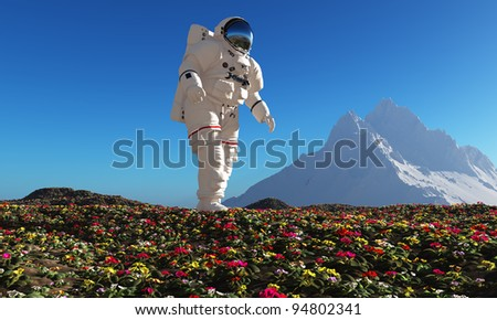 Astronaut goes on a field of flowers. - stock photo