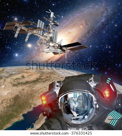 Astronaut helmet et alien extraterrestrial space ship ufo spaceship planet. Elements of this image furnished by NASA. - stock photo