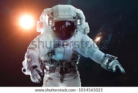 Astronaut in deep space. Symbol of space exploration. Elements of this image furnished by NASA