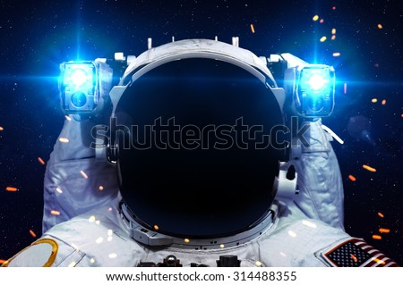 Astronaut in outer space against the black hole. Elements of this image furnished by NASA. - stock photo