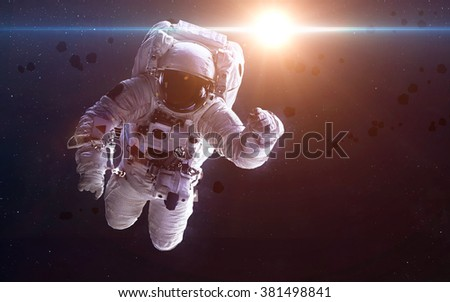 Astronaut in outer space. Elements of this image furnished by NASA - stock photo