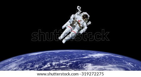 Astronaut in outer space over the planet earth.  This image is a collage of different images furnished by NASA - stock photo