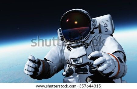 Astronaut in space above the clouds of the Earth.